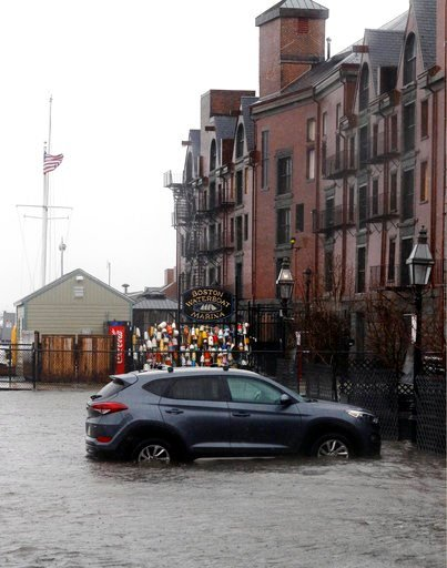 (AP Photo/Bill Sikes). A car sits in a Long Wharf parking lot flooded by water from Boston Harbor at high tide during a major nor'easter that pounded the East Coast, Friday, March 2, 2018, in Boston.