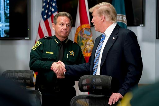 (AP Photo/Andrew Harnik). President Donald Trump shakes hands with Broward County Sheriff Scott Israel as he meets with law enforcement officers at Broward County Sheriff's Office in Pompano Beach, Fla., Friday, Feb. 16, 2018, following Wednesday's sho...