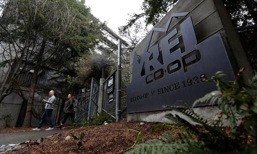 (AP Photo/Ted S. Warren). An entrance to the REI flagship store is shown Friday, March 2, 2018, in Seattle. The outdoor retailer says it's halting future orders of some popular brands, including CamelBak water carriers, Giro helmets and Camp Chef stove...