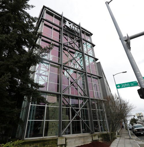 (AP Photo/Ted S. Warren). The indoor climbing tower at the REI flagship store is shown Friday, March 2, 2018, in Seattle.  The outdoor retailer says it's halting future orders of some popular brands, including CamelBak water carriers, Giro helmets and ...