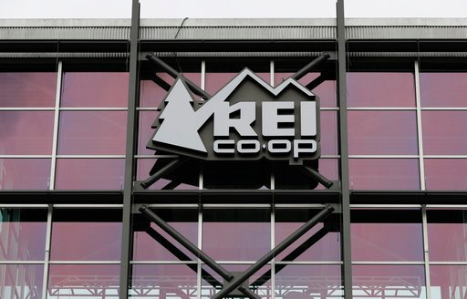 (AP Photo/Ted S. Warren). A sign at the REI flagship store is shown Friday, March 2, 2018, in Seattle. The outdoor retailer says it's halting future orders of some popular brands, including CamelBak water carriers, Giro helmets and Camp Chef stoves, wh...