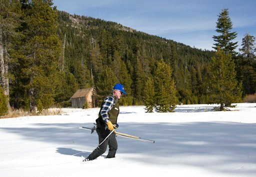 (AP Photo/Rich Pedroncelli,File). FILE - In this Feb. 1, 2018 file photo Frank Gehrke, chief of the California Cooperative Snow Surveys Program for the Department of Water Resources, crosses a snow covered meadow as he conducts the second snow survey o...