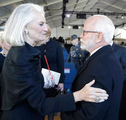 (AP Photo/Chuck Burton). CORRECTS SPELLING OF NAME TO ANNE GRAHAM LOTZ FROM ANN GRAHAM LOTS - Televangelist Jim Bakker speaks with Anne Graham Lotz after a funeral service at the Billy Graham Library for the Rev. Billy Graham, who died last week at age...