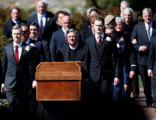 (AP Photo/John Bazemore). The casket of The Rev. Billy Graham is moved during a funeral service at the Billy Graham Library for the Rev. Billy Graham, who died last week at age 99, Friday, March 2, 2018, in Charlotte, N.C.