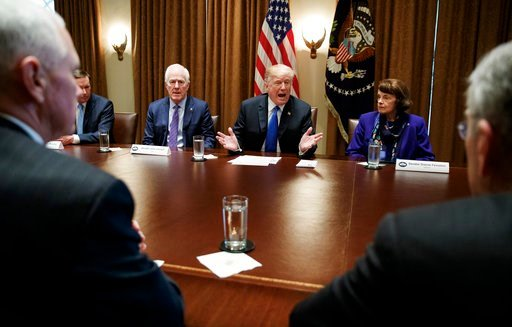 (AP Photo/Carolyn Kaster). President Donald Trump speaks in the Cabinet Room of the White House, in Washington, Wednesday, Feb. 28, 2018, during a meeting with members of congress to discuss school and community safety. With the president from left, Vi...