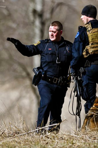 (Matthew Dae Smith/Lansing State Journal via AP). Law enforcement officers search a wooded area for a suspect involved in a shooting at a Central Michigan University residence hall on Friday, March 2, 2018 in Mt. Pleasant, Mich.  Two people who weren't...