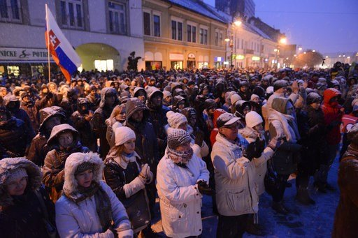 (Milan Kapusta/TASR via AP). People gather to commemorate murdered journalist Jan Kuciak and his fiancee, and call for a proper investigation of the case, in Kosice, Slovakia, Friday evening March 2, 2018. Seven men were detained Thursday as suspects d...