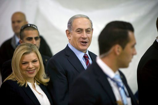 (AP Photo/Oded Balilty, File). FILE - In this Wednesday, Dec. 31, 2014 file photo, Israeli Prime Minister Benjamin Netanyahu, right, and Israel's First lady Sara Netanyahu arrive for the Likud party primary elections at the in Jerusalem. Israeli police...