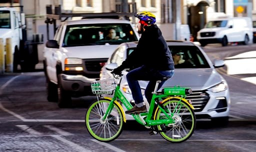 (AP Photo/Elaine Thompson). In this Feb. 22, 2018 photo, a man rides a shared electric-assisted bicycle in downtown Seattle. Shared bikes that can be left wherever the rider ends up are helping more people get access to the mode of transportation that ...