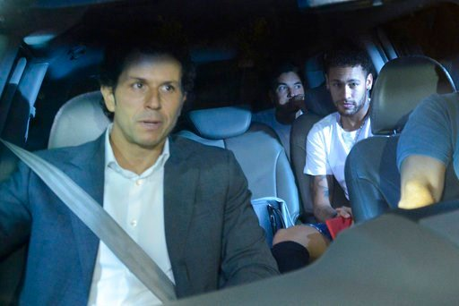 (AP Photo/Eugenio Savio). Brazil soccer star Neymar, right, and his doctor Rodrigo Lasmar, left, arrive to the Mater Dei Hospital, in Belo Horizonte, Brazil, Friday, March 2, 2018. Neymar will have surgery on a fractured toe in his right foot and could...