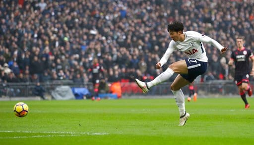 (John Walton/PA via AP). Tottenham Hotspur's Son Heung-Min scores his side's first goal of the game against Huddersfield, during their English Premier League soccer match at Wembley Stadium in London, Saturday March 3, 2018.