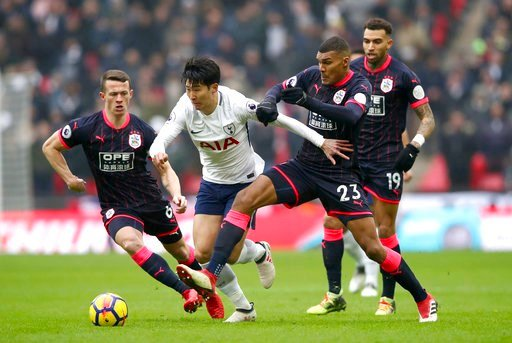 (John Walton/PA via AP). Tottenham Hotspur's Son Heung-Min, centre, and Huddersfield Town's Collin Quaner, centre right, in action during their English Premier League soccer match at Wembley Stadium in London, Saturday March 3, 2018.