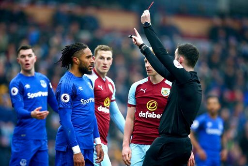 (Dave Thompson/PA via AP). Everton's Ashley Williams, 2nd left, receives a red card from Referee Chris Kavanagh during the match against Burnley during their English Premier League soccer match at Turf Moor, Burnley, England, Saturday March 3, 2018.