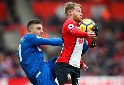 (Adam Davy/PA via AP). Stoke City's Kostas Stafylidis, left, and Southampton's Josh Sims in action during their English Premier League soccer match at St Mary's Stadium in Southampton, England, Saturday March 3, 2018.