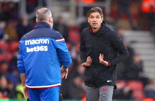 (Adam Davy/PA via AP). Southampton manager Mauricio Pellegrino, right, appeals to an official during the English Premier League soccer match between Southampton and Stoke City, at St Mary's Stadium in Southampton, England, Saturday March 3, 2018.