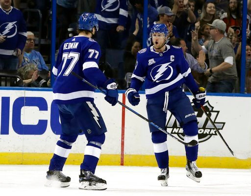 (AP Photo/Chris O'Meara). Tampa Bay Lightning center Steven Stamkos (91) celebrates his goal against the Philadelphia Flyers with defenseman Victor Hedman (77) during the first period of an NHL hockey game Saturday, March 3, 2018, in Tampa, Fla.