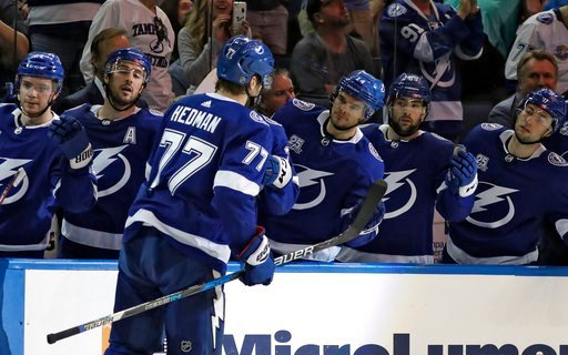 (AP Photo/Chris O'Meara). Tampa Bay Lightning defenseman Victor Hedman (77) celebrates with the bench after scoring against the Philadelphia Flyers during the second period of an NHL hockey game Saturday, March 3, 2018, in Tampa, Fla.