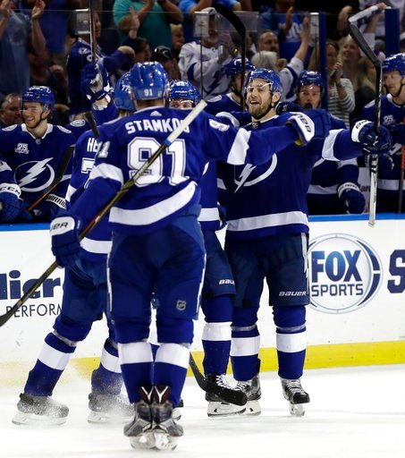 (AP Photo/Chris O'Meara). Tampa Bay Lightning defenseman Dan Girardi (5), right, celebrates his goal against the Philadelphia Flyers with teammates, cincouding center Steven Stamkos (91) during the second period of an NHL hockey game Saturday, March 3,...