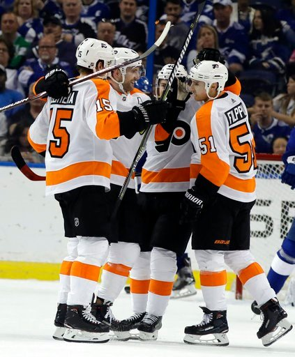 (AP Photo/Chris O'Meara). Philadelphia Flyers center Jori Lehtera (15) celebrates with teammates, including center Valtteri Filppula (51) after scoring against the Tampa Bay Lightning during the second period of an NHL hockey game Saturday, March 3, 20...