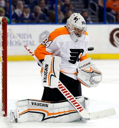 (AP Photo/Chris O'Meara). Philadelphia Flyers goaltender Petr Mrazek (34) makes a save on a shot by the Tampa Bay Lightning during the second period of an NHL hockey game Saturday, March 3, 2018, in Tampa, Fla.