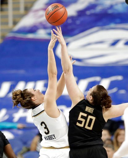 (AP Photo/Chuck Burton). Notre Dame's Marina Mabrey (3) shoots over Florida State's Chatrice White (50) during the second half of an NCAA college basketball game in the semifinals of the women's Atlantic Coast Conference tournament in Greensboro, N.C.,...