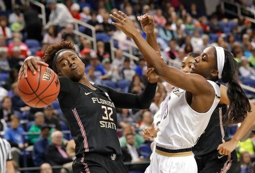 (AP Photo/Chuck Burton). Florida State's Imani Wright (32) steals the ball from Notre Dame's Jackie Young (5) during the first half of an NCAA college basketball game in the semifinals of the women's Atlantic Coast Conference tournament in Greensboro, ...