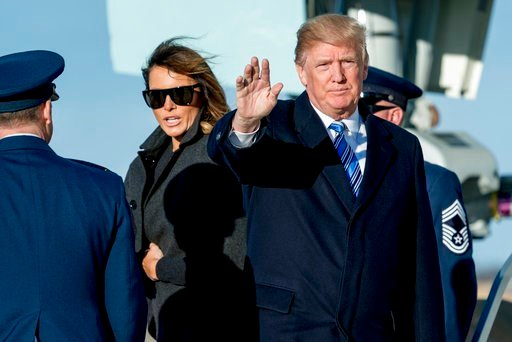 (AP Photo/Andrew Harnik). President Donald Trump, accompanied by first lady Melania Trump, waves to members of the media as they arrive at Andrews Air Force Base, Md., Saturday, March 3, 2018 to board Marine One for a short trip to the White House.