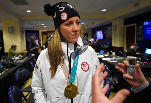 (AP Photo/Nick Wass). Meghan Duggan, of the gold medal winning US women's Olympic hockey team, listens to a question from the media before an outdoor NHL hockey game between the Washington Capitals and the Toronto Maple Leafs, Saturday, March 3, 2018, ...