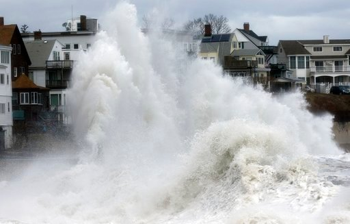 (AP Photo/Michael Dwyer). A large wave crashes into a seawall in Winthrop, Mass., Saturday, March 3, 2018, a day after a nor'easter pounded the Atlantic coast.