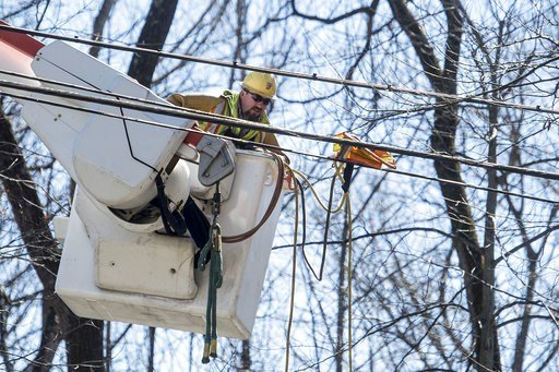 (Jay Westcott/The News & Advance via AP). Jeremy Gilbert works to repair a power line after a storm passed through the area on Saturday, March 3, 2018 in Lynchburg, Va.