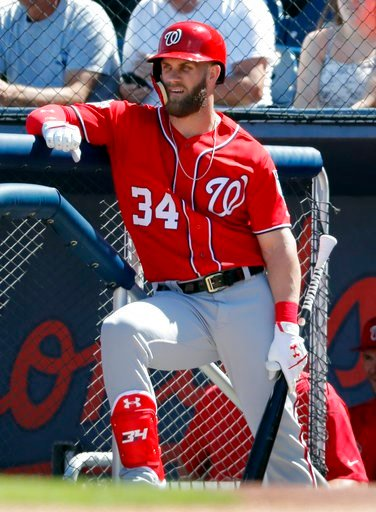 (AP Photo/Jeff Roberson). Washington Nationals' Bryce Harper stands on the dugout steps as he waits to bat during the first inning of an exhibition spring training baseball game against the Houston Astros, Saturday, March 3, 2018, in West Palm Beach, F...