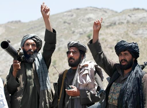 (AP Photos/Allauddin Khan, File). FILE - In this May 27, 2016 file photo, Taliban fighters react to a speech by their senior leader in the Shindand district of Herat province, Afghanistan. With U.S. support, the Afghan government has made a surprising ...