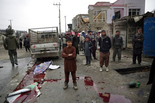 (AP Photo/Massoud Hossaini). Residents walk through the site of a suicide attack in Kabul, Afghanistan, Friday, March 2, 2018. A large explosion in the eastern part of the Afghan capital on Friday morning killed at least one and wounding others officia...