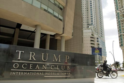 (AP Photo/Arnulfo Franco, File). FILE - In this Feb. 27, 2018 file photo, a police officer on a motorcycle leaves the Trump Ocean Club International Hotel and Tower in Panama City.  The hotel remains open for business against a backdrop of service inte...