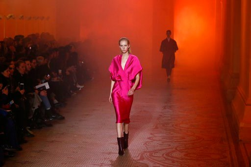 (AP Photo/Kamil Zihnioglu). A model wears a creation for Poiret ready-to-wear fall/winter 2018/2019 fashion collection presented in Paris, Sunday, March 4, 2018.