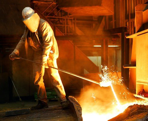 (AP Photo/Frank Austin, file). FILE - In this Sept. 22, 2005 file photo a steel worker takes a sample at the blast furnace of ThyssenKrupp steel company in Duisburg, western Germany. Ordering combative action on foreign trade, President Donald Trump ha...