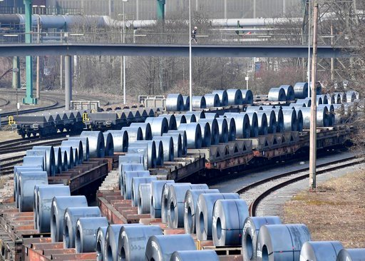 (AP Photo/Martin Meissner). Steel coils sit on wagons when leaving the thyssenkrupp steel factory in Duisburg, Germany, Friday, March 2, 2018. U.S. President Donald Trump risks sparking a trade war with his closest allies if he goes ahead with plans to...