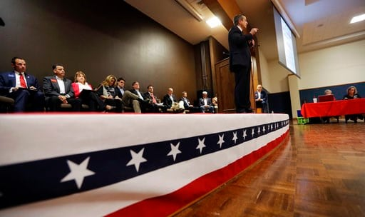 (AP Photo/Eric Gay). In this Tuesday, Feb. 13, 2018, photo, Matt McCall, standing, and other Republican congressional candidates attend a forum, in New Braunfels, Texas. Texas holds the nation's first 2018 primary elections Tuesday, March 6, 2018, and ...