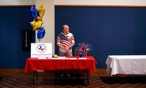 (AP Photo/Eric Gay). In this Tuesday, Feb. 13, 2018, photo, Kerry Ledford mans a booth at a Republican congressional candidate forum, in New Braunfels, Texas. Texas holds the nation's first 2018 primary elections Tuesday, March 6, 2018, and the campaig...
