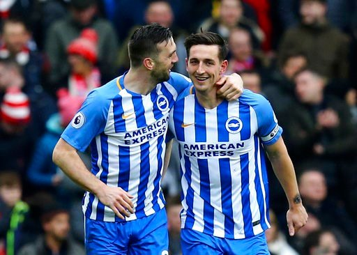 (Gareth Fuller/PA via AP). Brighton's Lewis Dunk, right, celebrates scoring his side's first goal of the game during the English Premier League soccer match between Brighton and Arsenal at the AMEX Stadium, in Brighton, England, Sunday March 4, 2018.