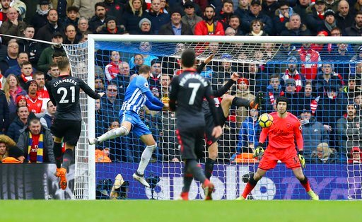 (Gareth Fuller/PA via AP). Brighton's Glenn Murray scores his side's second goal of the game, during the English Premier League soccer match between Brighton and Arsenal at the AMEX Stadium, in Brighton, England, Sunday March 4, 2018.