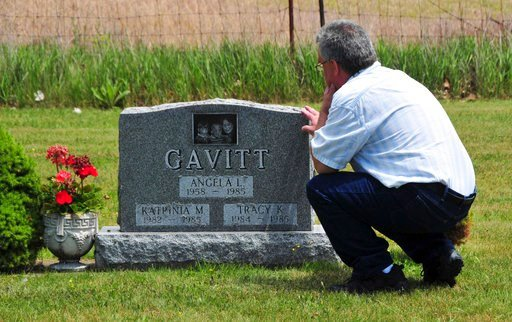 (John Masson via AP). In this June 6, 2012 photo provided by John Masson, David Gavitt visits the grave of his wife and two daughters in Ionia County, Mich., immediately after he was released from prison after 26 years. Gavitt was convicted of arson an...