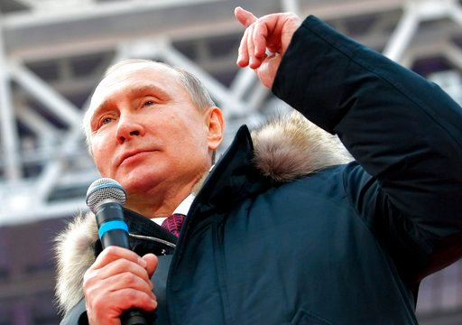 (Alexei Druzhinin, Sputnik, Kremlin Pool Photo via AP). Russian President Vladimir Putin gestures while speaking during a massive rally in his support as a presidential candidate at the Luzhniki stadium in Moscow, Russia, Saturday, March 3, 2018.