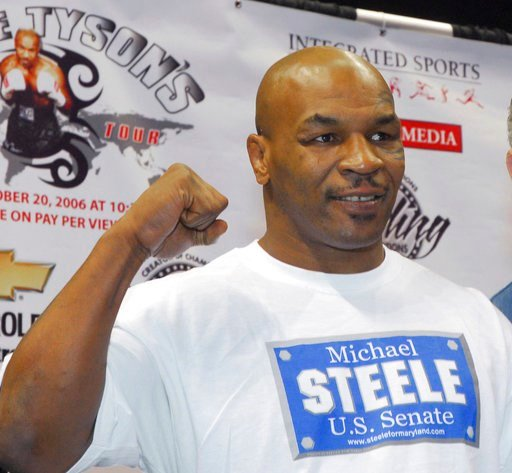 (AP Photo/Mark A. Stahl, File). FILE - In a Thursday, Oct. 19, 2006 file photo, former heavyweight champion Mike Tyson pumps his fist in the air during his weigh-in at the Chevrolet Centre in Youngstown, Ohio. Living Word Sanctuary Church is converting...