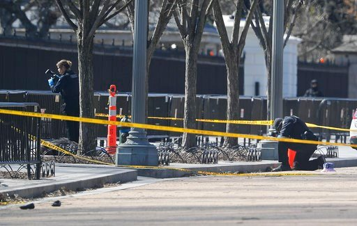 (AP Photo/Pablo Martinez Monsivais). Law enforcement officers photograph the area in front of the White House in Washington, which is close to pedestrian traffic, Saturday, March 3, 2018.  Authorities said a man shot himself to death outside the White ...