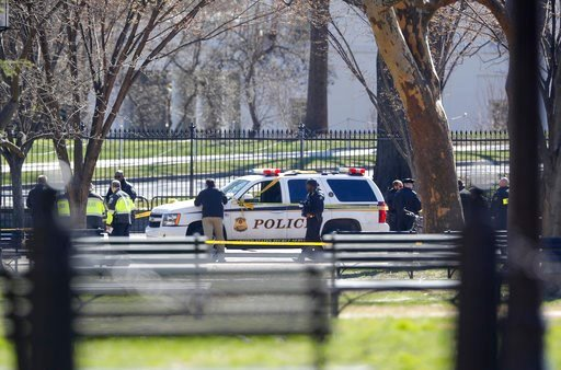 (AP Photo/Pablo Martinez Monsivais). Law enforcement officers gather infront of the White House in Washington, Saturday, March 3, 2018.    The Secret Service says a man shot himself outside the White House, and medical personnel are on the scene. Presi...