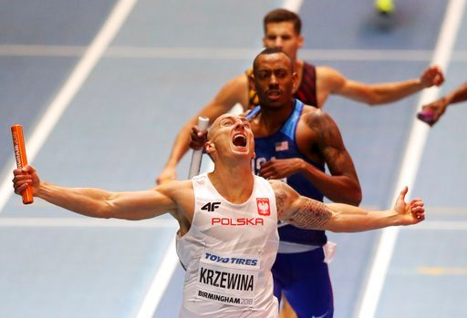 (AP Photo/Alastair Grant). Poland's Jakub Krzewina celebrates after winning the gold medal in the men's 4x400-meter relay final at the World Athletics Indoor Championships in Birmingham, Britain, Sunday, March 4, 2018.
