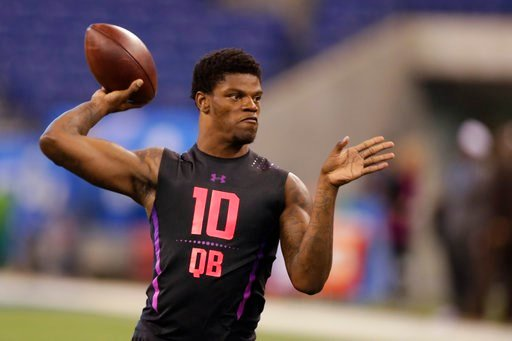 (AP Photo/Michael Conroy). Louisville quarterback Lamar Jackson runs a drill at the NFL football scouting combine in Indianapolis, Saturday, March 3, 2018.