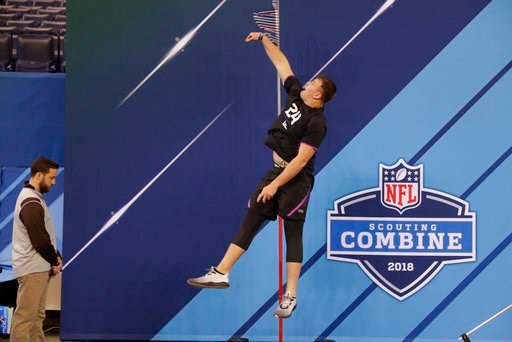 (AP Photo/Michael Conroy). Notre Dame offensive lineman Mike McGlinchey runs a drill at the NFL football scouting combine in Indianapolis, Friday, March 2, 2018.