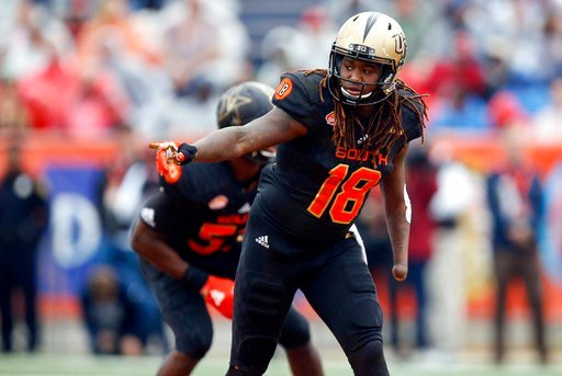 (AP Photo/Brynn Anderson, File). FILE - In this Jan. 27, 2018, file photo, South Squad outside linebacker Shaquem Griffin, of Central Florida, gestures during the first half of the Senior Bowl NCAA college football game in Mobile, Ala,. Griffin was 4 y...